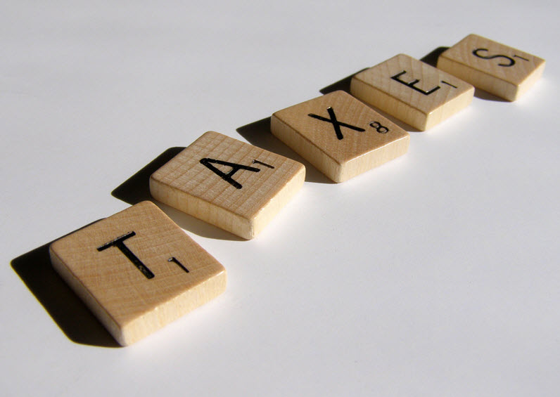 Scrabble tiles spelling out taxes