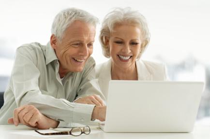 senior couple looking at a computer